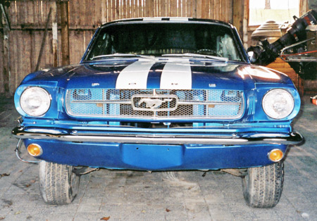 The 1965 Mustang uses a chrome waffle plate grille.