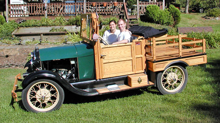 The first iteration of Ethel was the Huckster Farm truck bed shown with Mike son Casey and daughter-in-law Michelle.