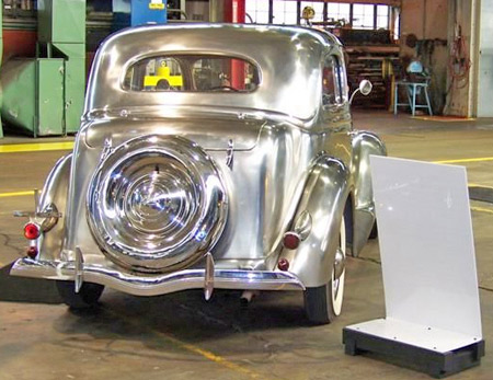 The smooth curves are obvious in this rear view of the stainless 1936 Ford and really show off the beauty of the metal, which competes very successfully for bling points with the chrome of the bumpers.