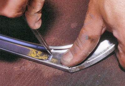 Gently push on the dents to return them to their original shape.